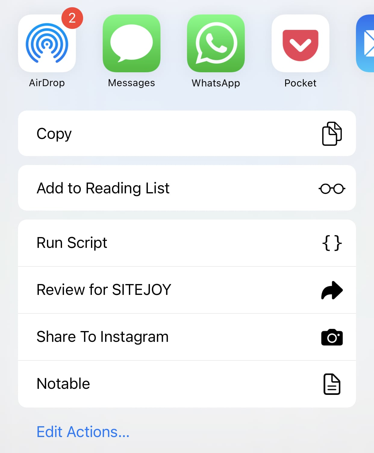 screenshot of the iOS share sheet with only the relevant apps, actions and shortcuts available for handling a URL